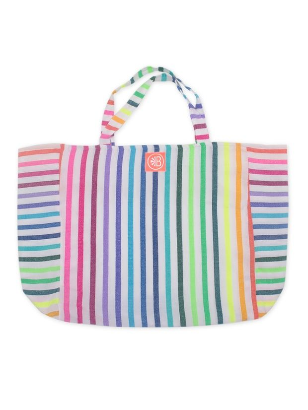 Stripes-on-stripes make a decidedly cool statement and this oversized tote bag by Las Bayadas is no exception. Colorful hues make it an ideal carry-all for the beach; fit your towel, sunnies and so much more! Tassel bag charm is sold separately and not included in this purchase.   Made by Las Bayadas.