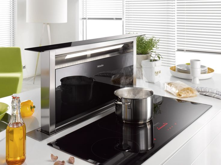 Another extraction solution for kitchen islands is the Miele DA6890 Levantar Cooker Hood, seen here with the Miele Induction Hob for a sleek finish that stores away neatly without interrupting the design of the island #kitcheninspiration