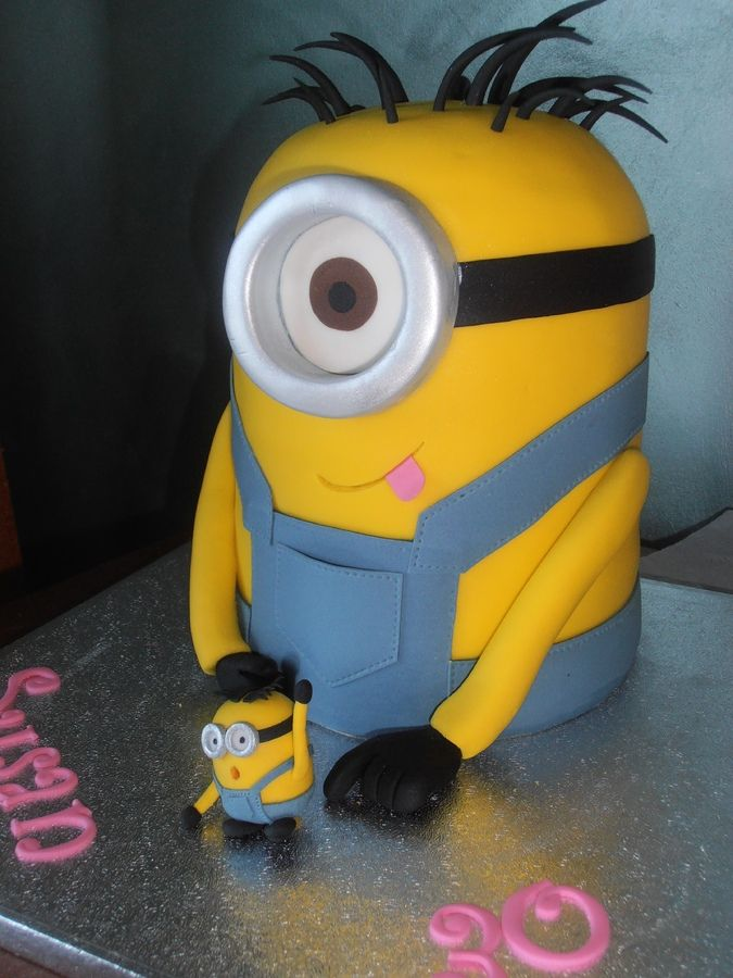 yellow vanilla sponge cake with white ganache filling and covered in fondant. Mini minion made from gumpaste/sugarpaste mix.