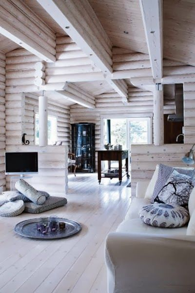Rustic chic does not mean that you can't whitewash the wood... this is a perfect example of updating a log home it gives it a fresh young look so modern looking and contemporary. Even though this is a new build.