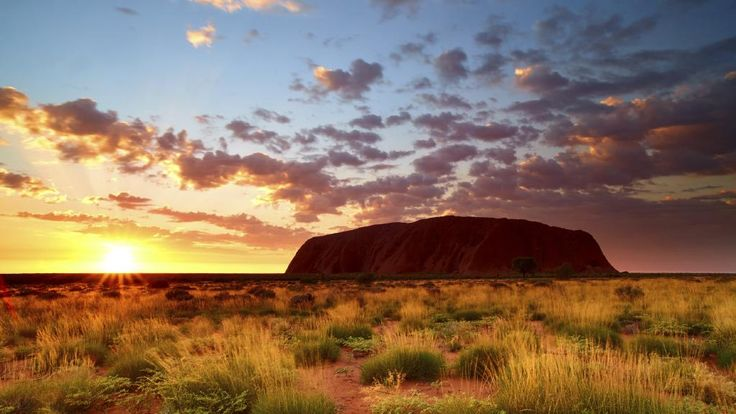 Sunrise is a spectacular time to see Uluru. Picture: iStock
