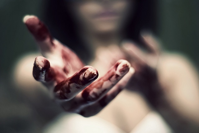 """""""I won't hurt you,"""" she whispered smiling wildly. I shrunk against the wall and shut me eyes trying to ignore the blood covered hand she held out for me. """"This is no way to treat your king"""" I spoke"""