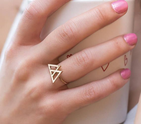 Triple Triangle Gold Ring  -----------Description---------------  This ring reminds me of a mountain top, of reaching the peak of a journey. The triangle has beautiful symbolism, and these two triangles that come together to make a third only multiply its meaning. This 18k gold plated ring is adjustable to fit any finger.  ∧ Each piece at Ninth Temple is cleansed with sacred sage smoke and blessed with Reiki. Reiki is an energy healing that channels Life Force Energy. Every crystal is