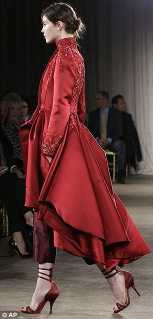 Marchesa's first fall 2013 look showed a scarlet equestrian coat with a high collar and full skirt - paired with compelling silk matador trousers