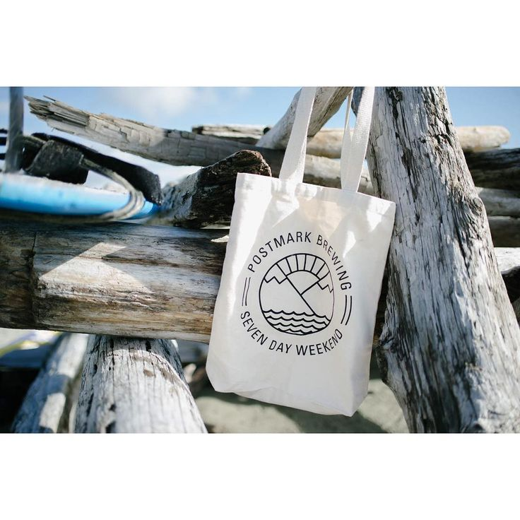 Seven Day Weekend - Tote | Beach approved. Photographed, Natural w/ Black Print. Available at the Postmark Retail Store #postmarkbrewing #postmarkapparel #sevendayweekend #westcoast #surf