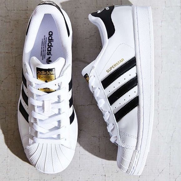 Adidas Superstar Shoes in White/Black These Superstar Shoes run a whole size big. Shoes are a women's 8.5 but fit as a 9.5 which is why they are posted as such. Never been worn! The supreme ruler of the sneaker world since the '70s, the adidas Superstar shoe is here to stay. These men's shoes stay true to the legacy in a full grain leather upper with serrated 3-Stripes and the authentic rubber shell toe. Full grain leather upper Classic rubber shell toe Comfortable textile lining…