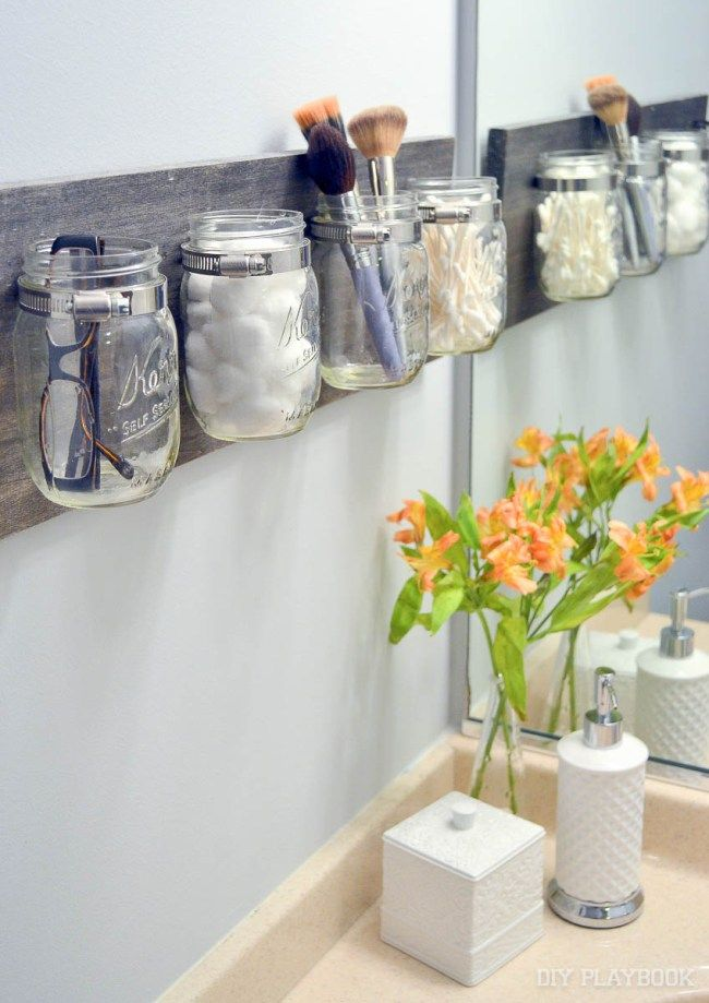 Love this mason jar organizer to corral all of your bathroom essentials. Such an easy DIY idea and pretty decor for any space in your home. It only takes about 30 minutes of your time to whip this baby up!