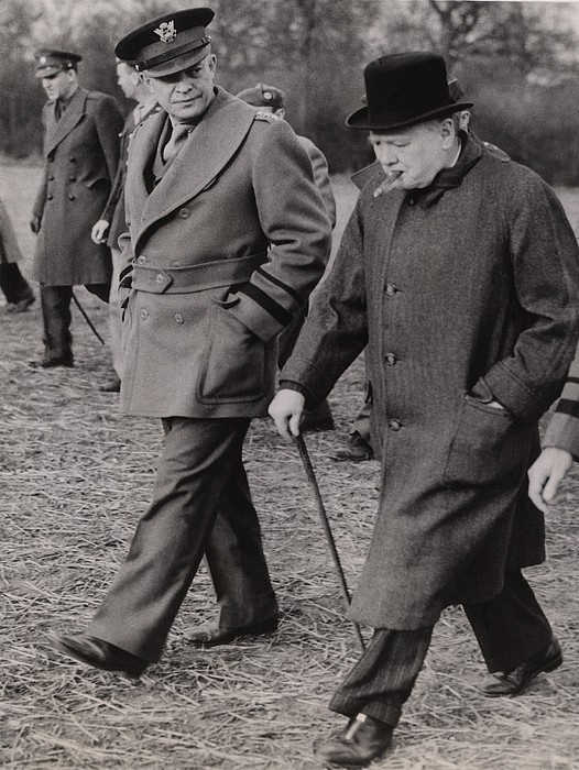 General Dwight Eisenhower, and Prime Minister Winston Churchill inspect a U.S. glider and paratroop invasion demonstration prior to the D-Day invasion of Normandy in 1944.