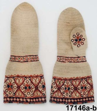 Nalbound mittens, Dalby, Sweden. Estimated time of production 1750-1800. Probably used as bride's mittens. It is possible this kind of mittens were bought in Norway. Length 36 cm, width (at cuff) 17 cm.
