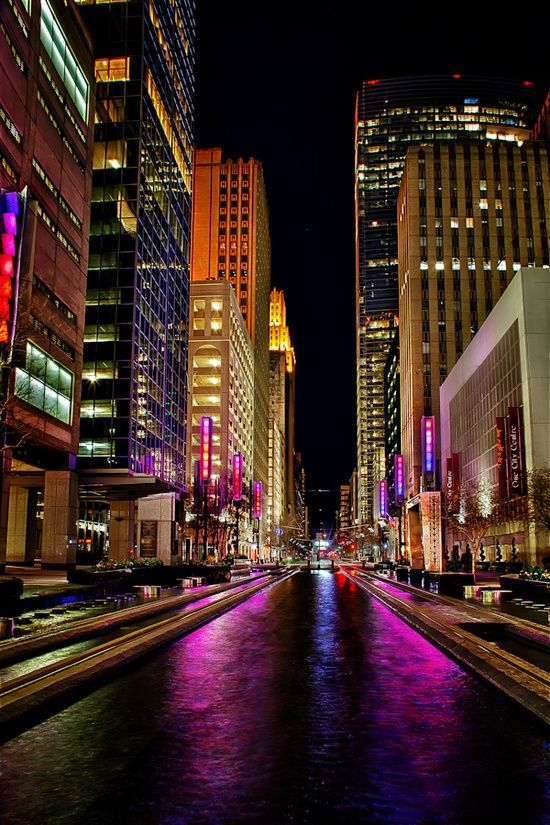 An open street in a big city, late at night.  Reminds me of a night, staying on the 7th floor of the Drake Hotel in Chicago, waking up at about 3:00am and hearing the sports cars and drag racers on the streets below.  Night time on the city streets is their time - a different world....