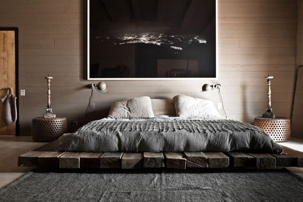 Gorgeous rustic platform bed in a cozy bedroom