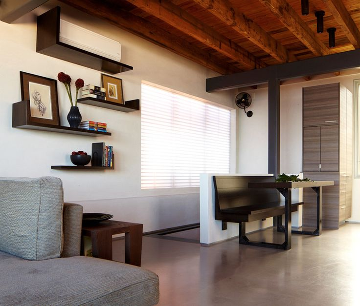 The shelving on this wall does a good job of incorporating and hiding the A/C unit.
