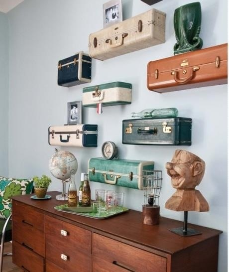 Danielle Mazur: Old suitcases used as shelving. It is a way of reusing something that is unwanted and finding a practical use for it. It also adds a great uniqueness to the room, creating a focal point.