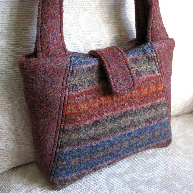 Purses made from recycled felted sweaters.  Lots of examples via Flickr
