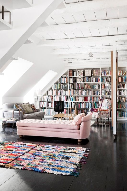 I'd have room for 1/3 of my books in this one room! Ceiling to floor bookshelves with a spacious loft feel