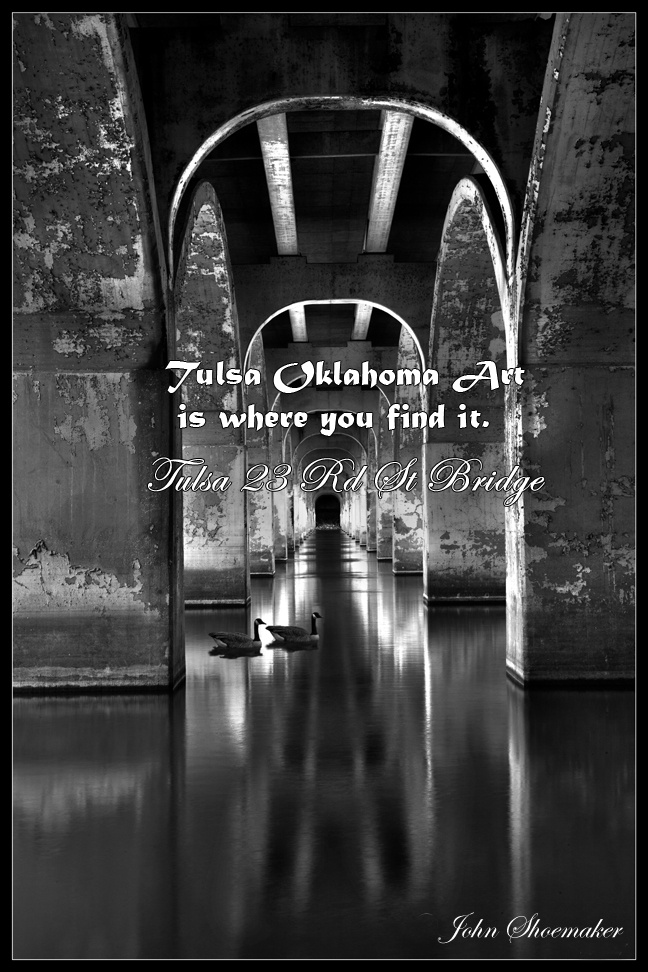 Tulsa-photos posters and pictures of Tulsa Oklahoma    Tulsa skyline 21st bridge almost night. Scenic bridge over the Arkansas River/Zink Lake. Tulsa's annual Independence Day Fireworks Spectacular is centered here. Oklahoma acquired its longest concrete bridge (1,880 feet) when Tulsa raised funds through a bond issue to build a twenty-one span, open spandrel arch bridge across the Arkansas River.  By John Shoemaker #Tulsa #wall #art #pictures