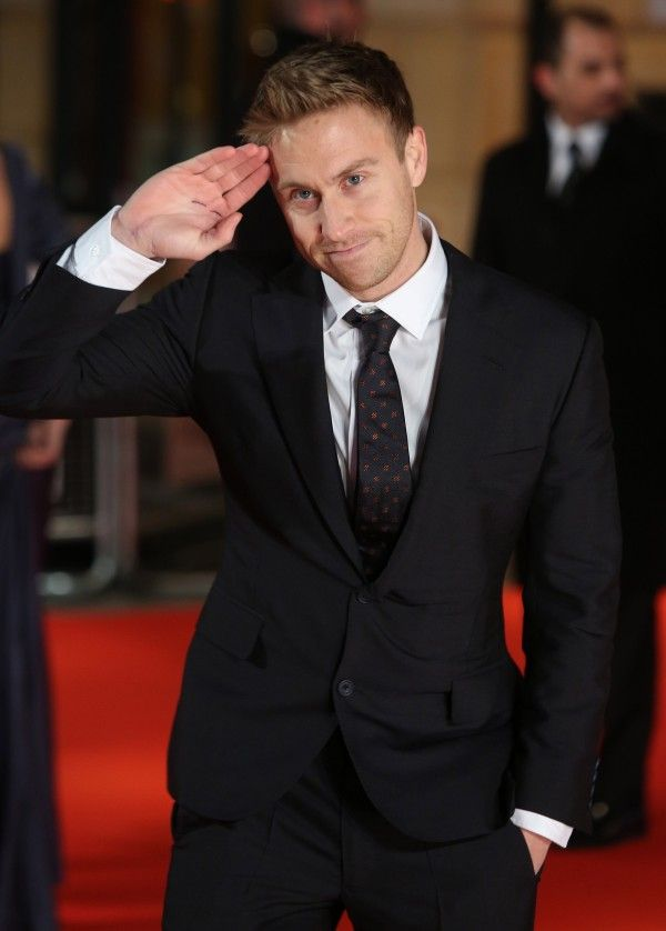 Suited and booted Russell Howard