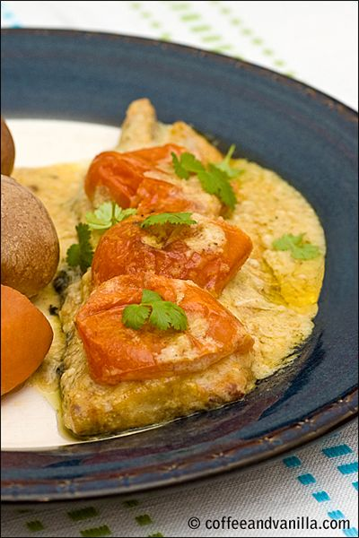 Baked mackerel in coconut sauce with Caribbean curry and tomatoes