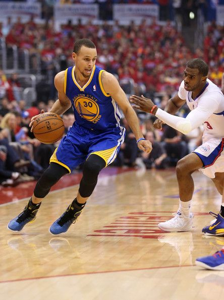 Stephen Curry #30 of the Golden State Warriors drives past Chris Paul #3 of the Los Angeles Clippers during the 2014 NBA Playoffs in Game Seven.