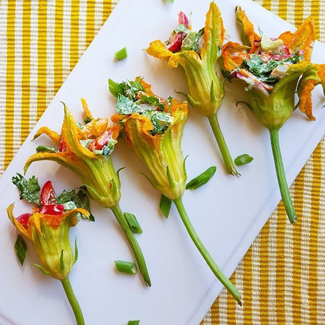 SRoot-to-Stem Dining - stuffed squash blossoms with garlic cream, avocado, red onion, peppers, and cilantro.