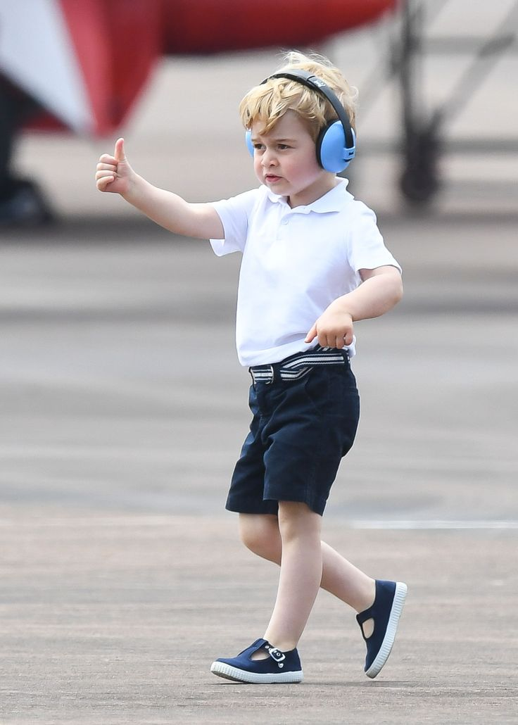 July 8, 2016 ~ Prince George at His First Official Royal Engagement in the UK: HRH Prince George gives the thumbs up at the the Royal International Air Tattoo at RAF Fairford where the visit had everything that might interest the young royal who will turn three in just a few weeks such as planes, helicopters and daddy showing off helicopters that he used to fly. ~ Photo Courtesy of Town & Country Magazine.