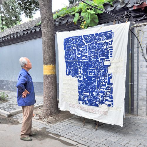 8 maps of Hutong > beijing 1000 km² areas embroidered with techique used for the communist propaganda of the seventies hanging on public wires and ropes ::: marcella campa & stefano avesani