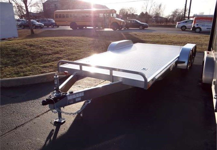 """8.5' x 18' All Aluminum Open Car Hauler. This Is a Very Nice 8.5' x 18' Open Car Hauler Trailer with Stowable Rear Ramps and a 6"""" Front Railing. $6,195 Any applicable fees and taxes are extra. Ref # HE207994   Advantage Trailers and Hitches"""