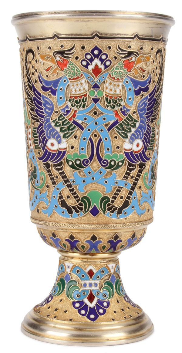 RUSSIAN SILVER GILT AND CLOISONNÉ ENAMEL FOOTED BEAKER, MARIA ADLER, MOSCOW, 1877. Resting on a spread foot, the cylindrical body with flared lip and the sides colorfully enameled with fanciful winged griffins and strapwork on a stippled gilt ground.