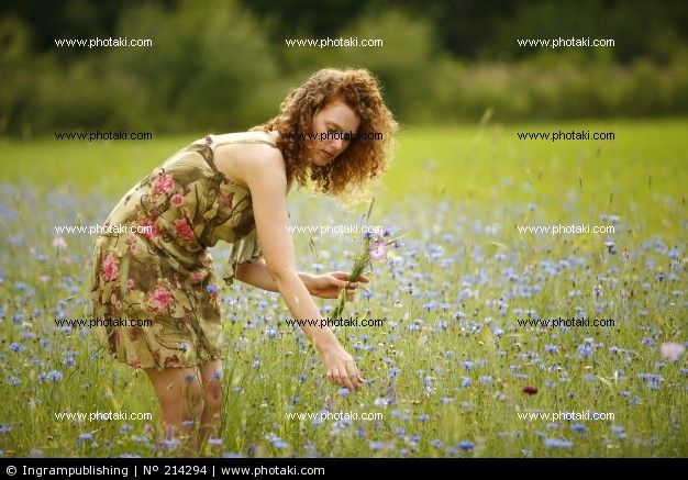 http://www.photaki.com/picture-a-beautiful-woman-picking-flowers-happiness-relax_214294.htm