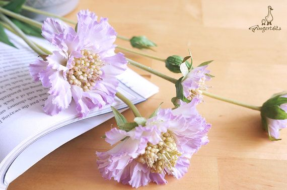 """Light Purple Scabiosa Each stem measures approx. 21"""" in length. Each stem has 2 flowers and 1 bud. Each flower measures approx. 1 1/2"""" – 3"""" wide and each bud measures approx. 1/2"""" wide. The listing is for ONE stem. Available in four colors:  1. Light Purple 2. Purple 3. Apple Green 4. White  ** This scabiosa can be ordered WITH or WITHOUT the stem.  {Perfect for} - bridal bouquet, corsage, boutonniere, headpiece and wedding crown - gift packaging - wedding, anniversary, birthday, pa..."""