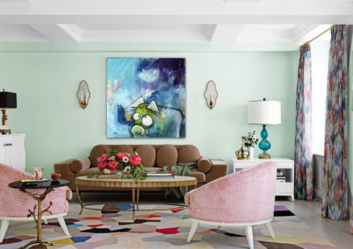Here's a decorating tip - here's one of my paintings placed in a colorfull livingroom.   The size of the painting is 100cm x 100cm. Watch how the blue and greenish in the painting match the color of the wall and the couch.