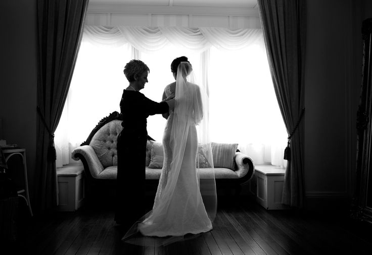 Finishing touches on the dress with mum Salt Studios  Toowoomba Wedding and Commercial Photography