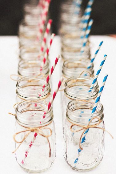 mason jars with red, white and blue striped straws