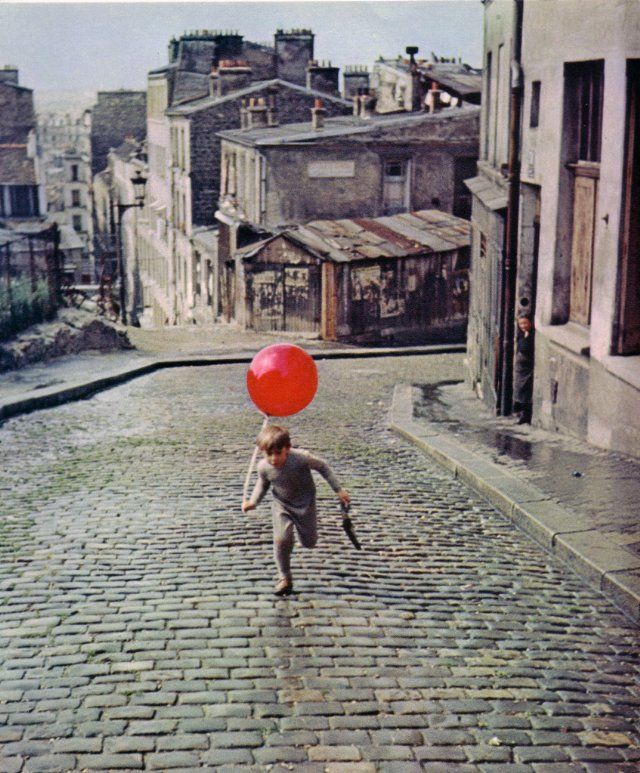 Still of Pascal Lamorisse in The Red Balloon.