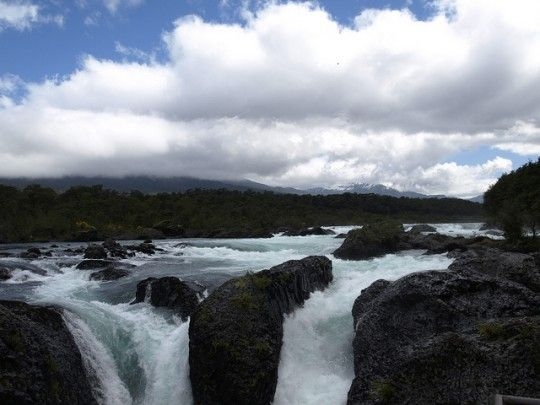 The Petrohué waterfalls flow down through these basaltic canyons from Lago Todos Santos in Chile's Lakes District