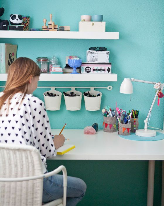 Shelves, storage pots, and rails make perfect space-saving storage for desks.