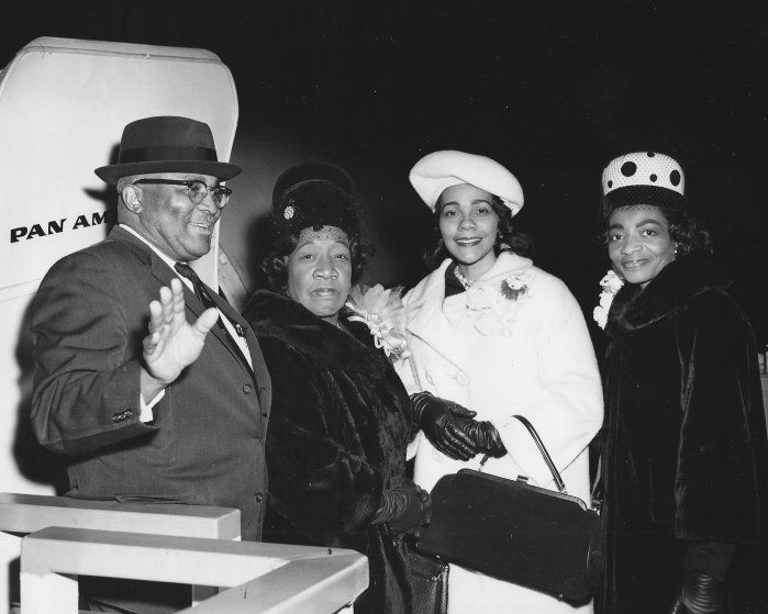 Martin Luther King Sr.; Alberta Williams King; Coretta Scott King; and Christine King board a plane in 1964, en route to King Jr.'s Nobel Peace Prize presentation ceremony.