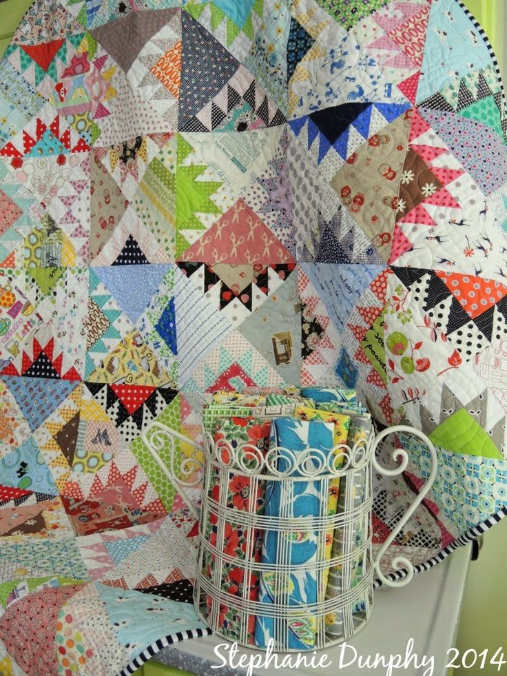 What a great scrappy quilt- I like the blocks which give it such a random vintage left over blocks look!