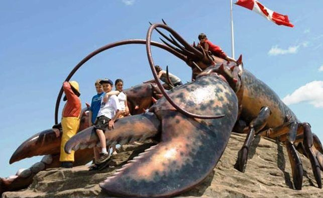 """Canada's Coolest Roadside Attractions   """"New Brunswick's World's Largest Lobster"""" • If you're not one for creepy-crawly things, you may want to avoid stopping in Shediac, lobster capital of the world. If you don't mind 'em, the 35-foot-long 90-tonne lobster statue on the edge of town is the world's largest, and is very photogenic.   by Nicholas Maronese   9"""