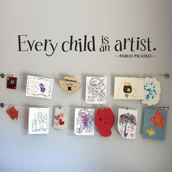 "Use the wire curtain ""rods"" from IKEA and the clippy thingies for $2ish to hang kiddos' art work."