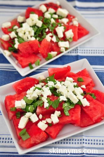 I want to eat this right now. Love the combo of the salty cheese and the sweet fruit. EASY and great for August. Herby Juicy Watermelon Tomato and Feta Salad! #skinnyms #easy recipe