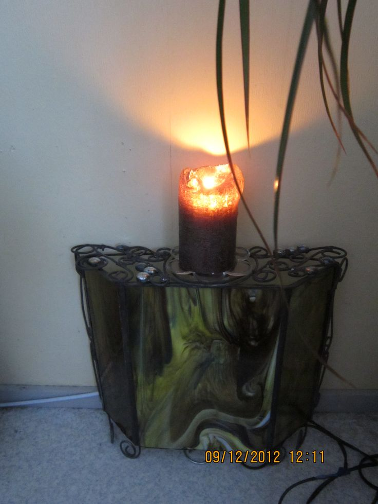 Lampshade is also functioning as a level for a candle