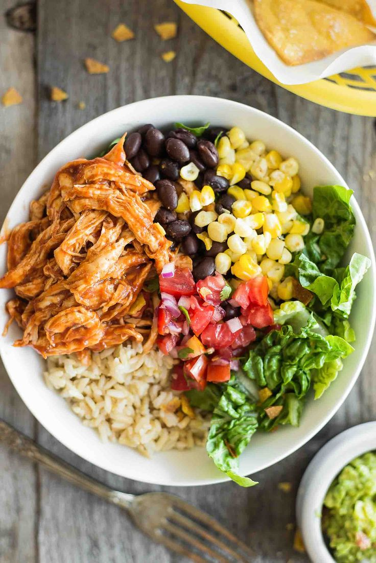 BBQ Chicken Burrito Bowl ~ Make-ahead BBQ Chicken Burrito Bowl with corn, black beans, and pico de gallo. Great for lunch or dinner during busy weeks! ~ SimplyRecipes.com