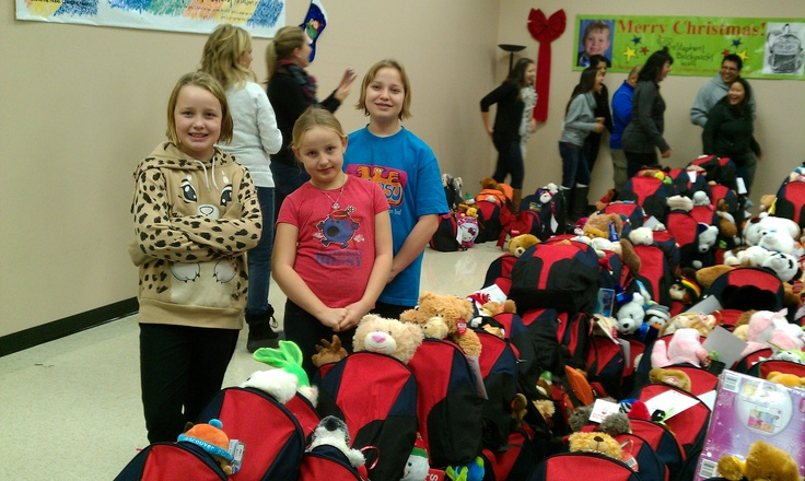 That day, my girls and I helped stuff over 250 backpacks for girls and boys aged 2-4.