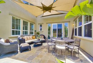 Tropical Porch with Suzanne Kasler Versailles Ottoman, California Gold Slate Outdoor Tile, slate tile floors, High ceiling