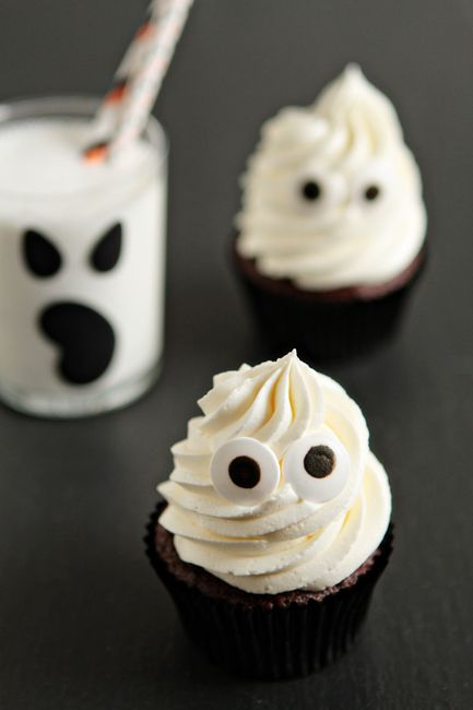 "Halloween Ghost Cupcakes -Inspiration for all of you procrastinators out there. With a little help from a ""Doctored Up Cake Mix"", you can totally pull them off one day before Halloween!"