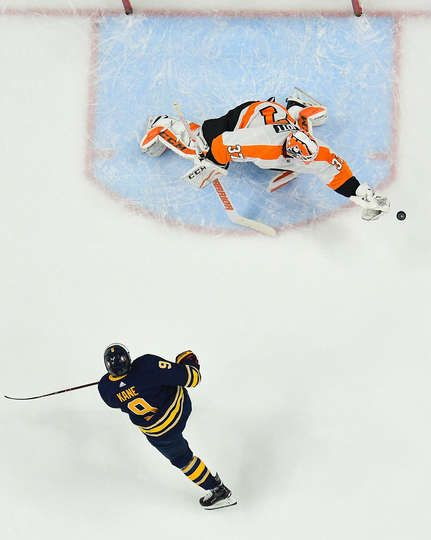 BUFFALO, NY - DECEMBER 22: Brian Elliott #37 of the Philadelphia Flyers makes a glove save on a penalty shot by Evander Kane #9 of the Buffalo Sabres during an NHL game on December 22, 2017 at KeyBank Center in Buffalo, New York. (Photo by Gary Wiepert/NHLI via Getty Images)