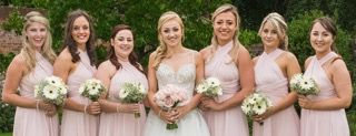 Pink Roses and white gerbera wedding flowers
