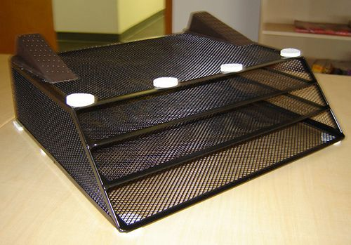DIY ventilating laptop stand using a file organizer, two doorstops, and some chair glides. stick by oldwisemonk, via Flickr