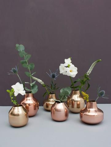 Metal Bud Vase Trio by Bohemia in metallic brass or copper, handmade in India in the Moradabad region of the country, a renowned center for handmade metal work. A contemporary mix of three varying sizes, these small round vases make the perfect gift.